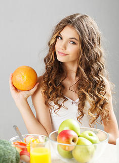 Young cute girl with grapefruit
